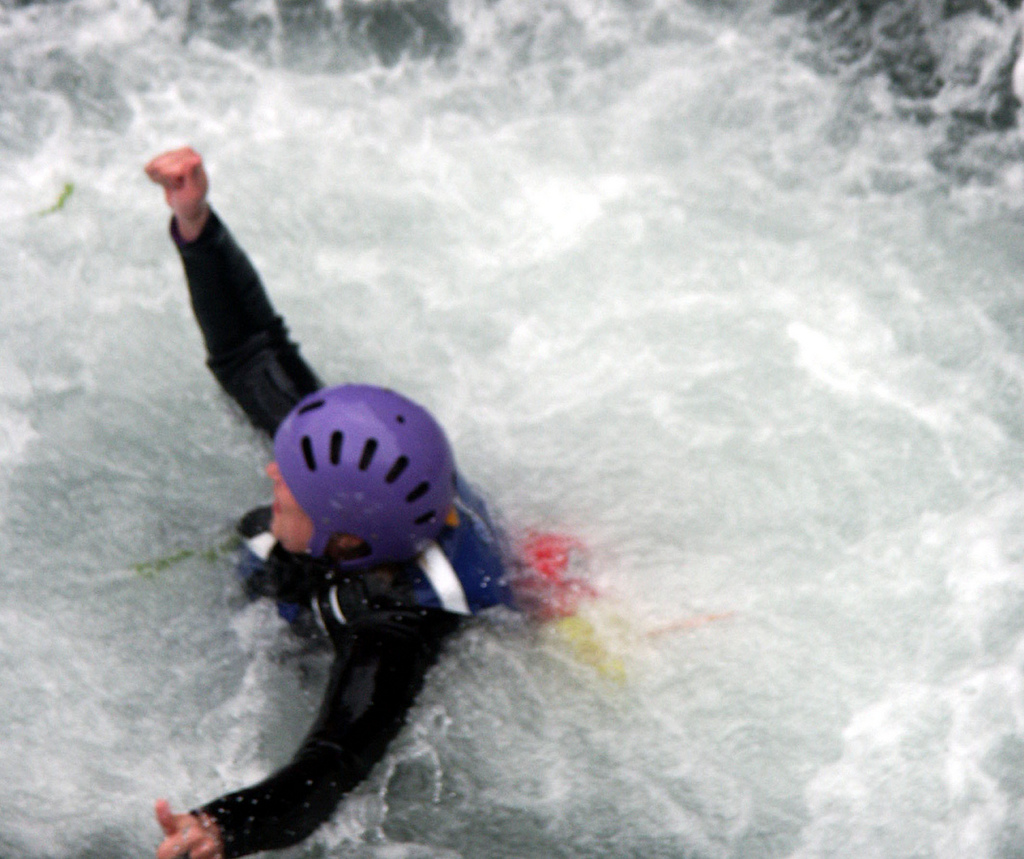 A coasteering helmet of an adventurer enjoying the water